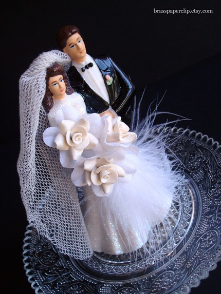 Restored vintage cake topper by BrassPaperClip, found on Etsy